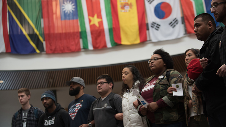 Students stand linked together in the Hemmingson Center.