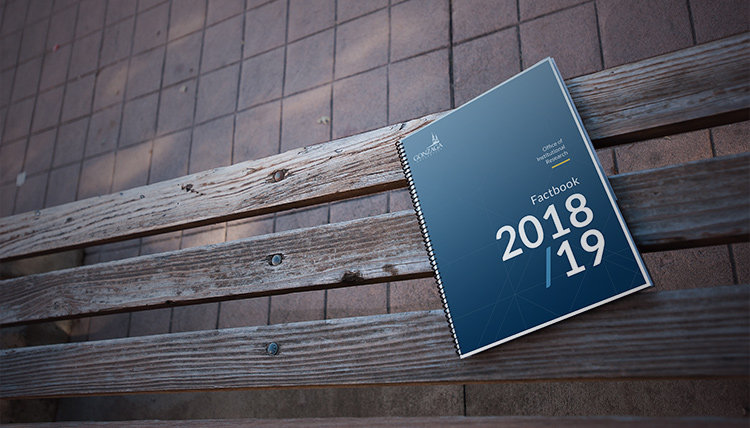 The 2018/19 Factbook sits on a bench on campus