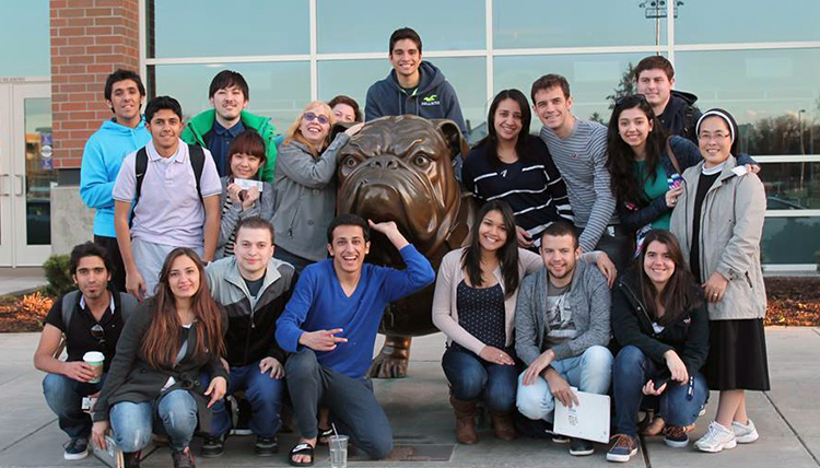 ESL students with the statue of Spike
