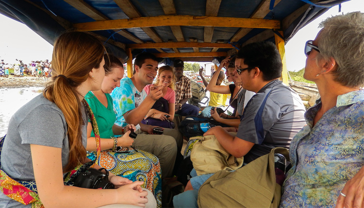 Study Abroad students in Benin traveling by bus.