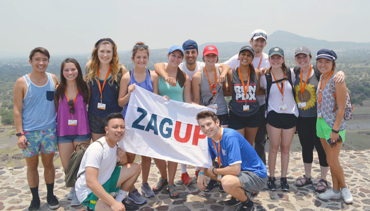Study Abroad students group photo on top of the Sun Pyramid in Mexico