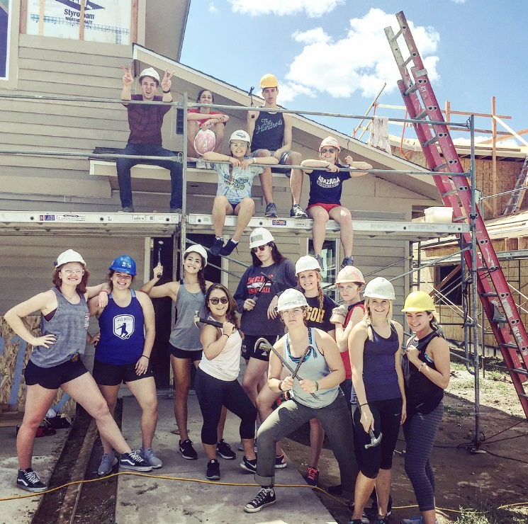 Group of STEP and GUST students at a habitat for humanity job site