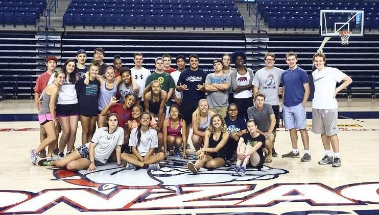 Group of STEP and GUST students at center court of McCarthy Athletic Center