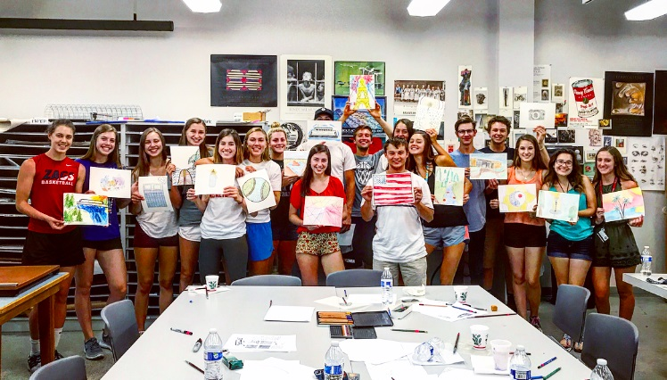 Group of STEP and GUST students holding artwork from a workshop event.