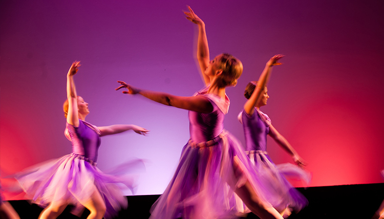 Girls performing ballet on stage.