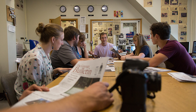 Gonzaga University Integrated Media Journalism Students around a table