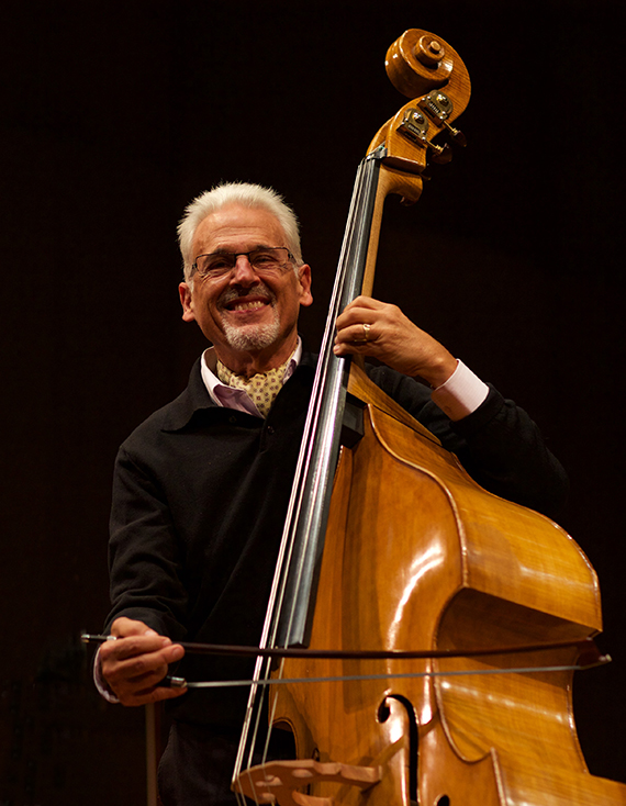 Musician Gary Karr stands next to his double bass.