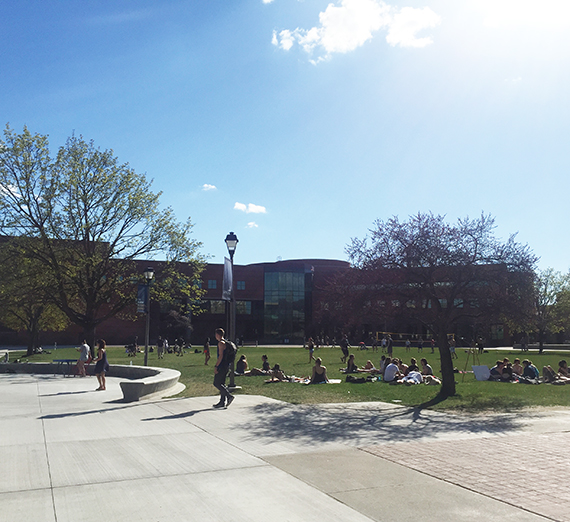 Foley in spring with students outside enjoying the sun