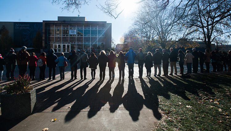 The International Day of Tolerance gathered students, faculty, and staff together and they linked arms to form a human chain of solidarity.