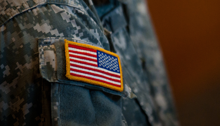 Flag on a military uniform at a veterans event on campus