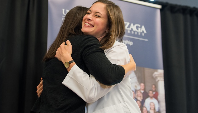 Family and friends join together to watch the newly admitted UW and Gonzaga University joint students receive their white coats on September 2nd, 2016 in the Hemmingson Center Ballroom at Gonzaga University.