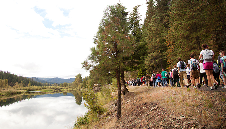 Students hiking along Spokane river