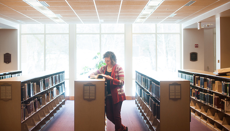 Woman studying in Chastek Library