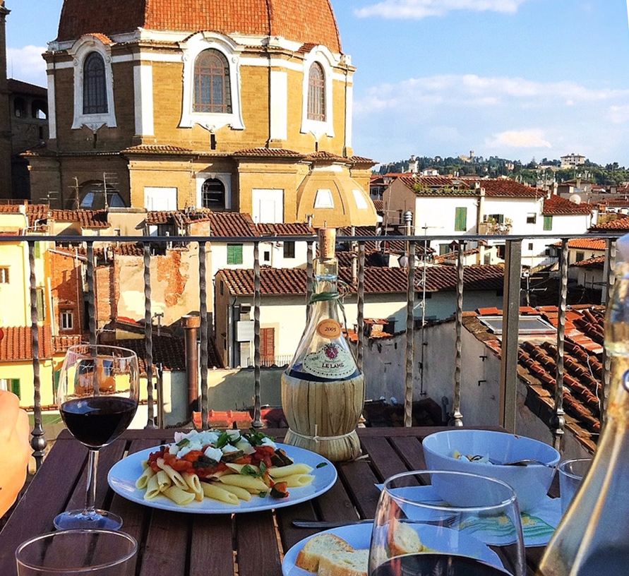 Dining on the balcony in Florence, Italy
