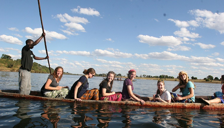 Study abroad students boating on the water.