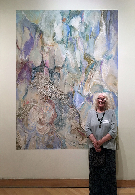 Christine Kimball stands in front of her 8 foot by 11 foot artwork.