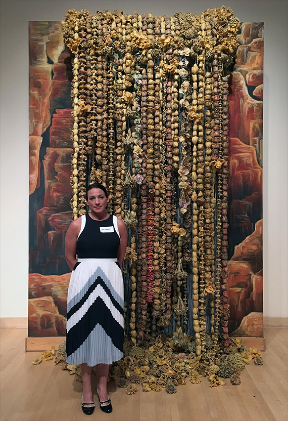 Jamie Nadherny stands in front of her 8 foot by 11 foot artwork.