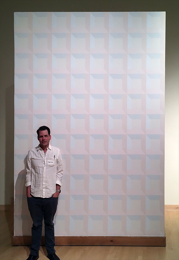Robert Fifiled stands in front of his 8 foot by 11 foot artwork.