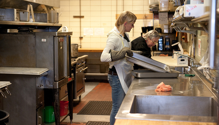 Campus Kitchens in Cataldo works with students to prepare and serve people in the community.
