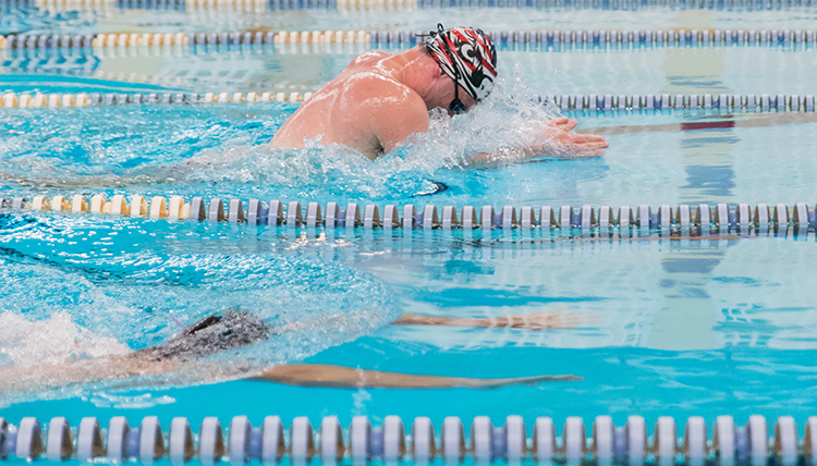 GU male student swims laps in the RFC pool