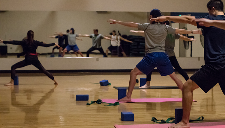 GU students participating in a yoga class