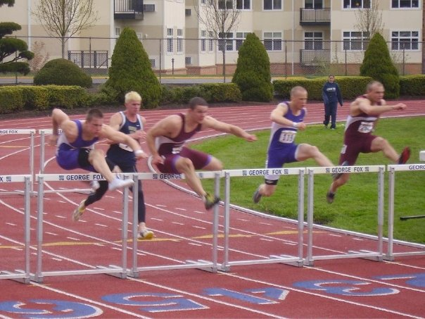 students hurdling on track