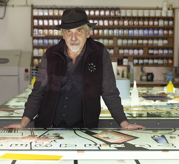 Art Spiegelman stands over a light table with artwork.