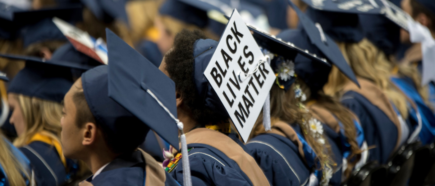 "Student at commencement ceremony with a graduation cap that says ""Black Lives Matter"""
