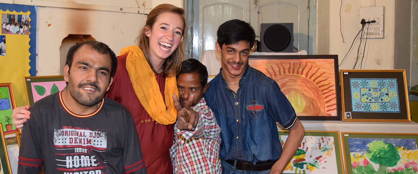 Katie Moore poses for a photo with students at the Deva Center in Varanasi, India
