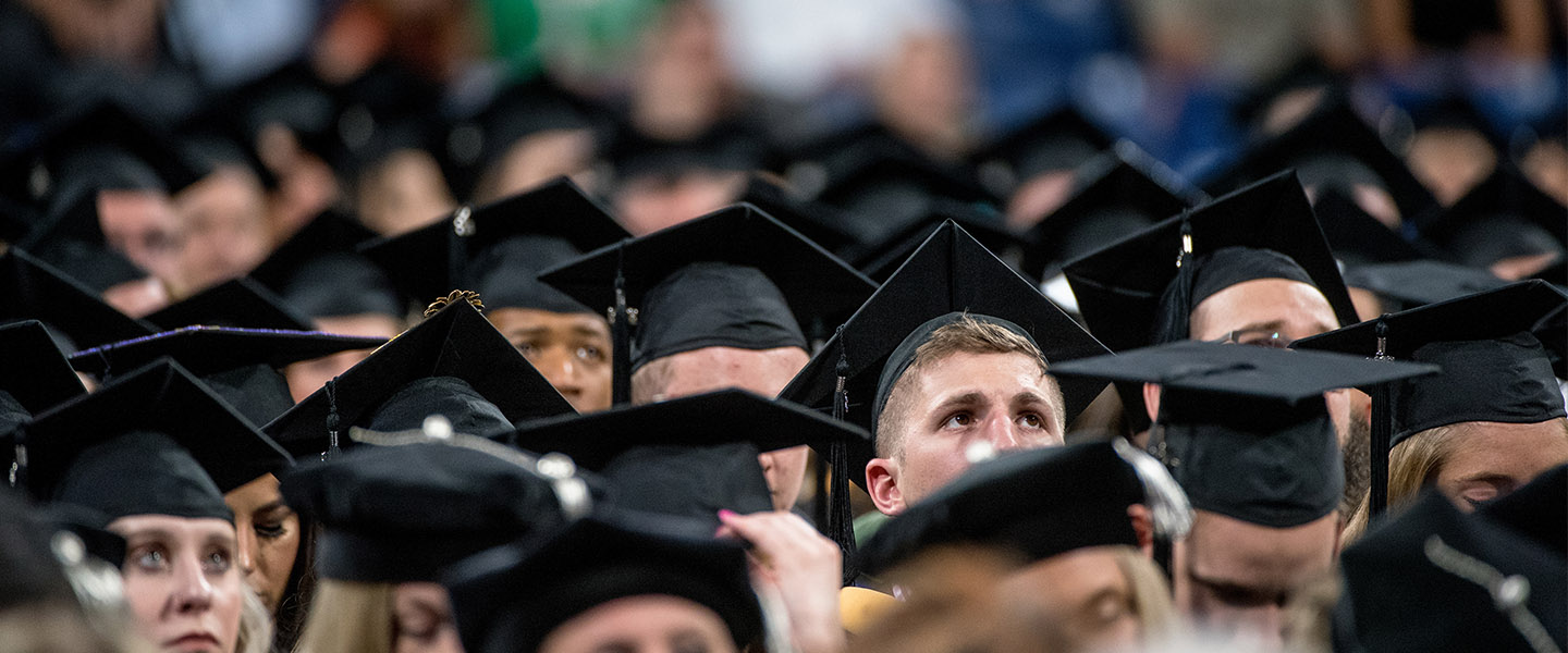 Students looking on at 2018 Graduate Commencement ceremony