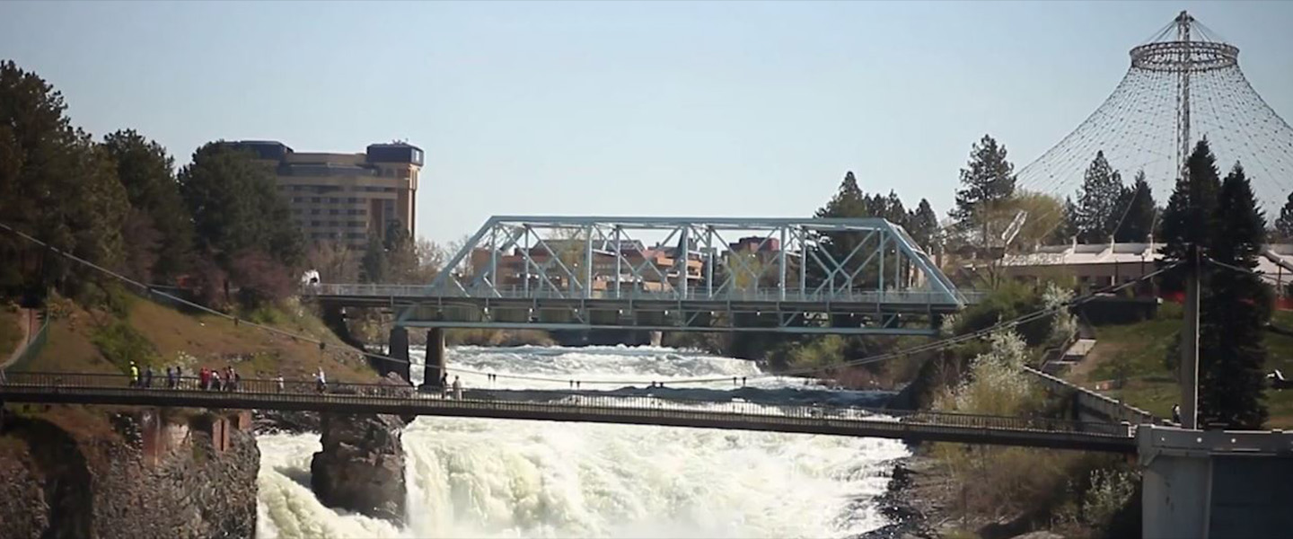 A bridge crossing over a waterfall in Spokane Washington
