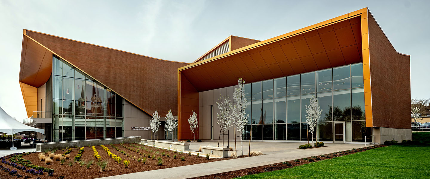 Exterior of Myrtle Woldson Performing Arts Center showing Recital Hall, lobby windows, and landscaped plaza