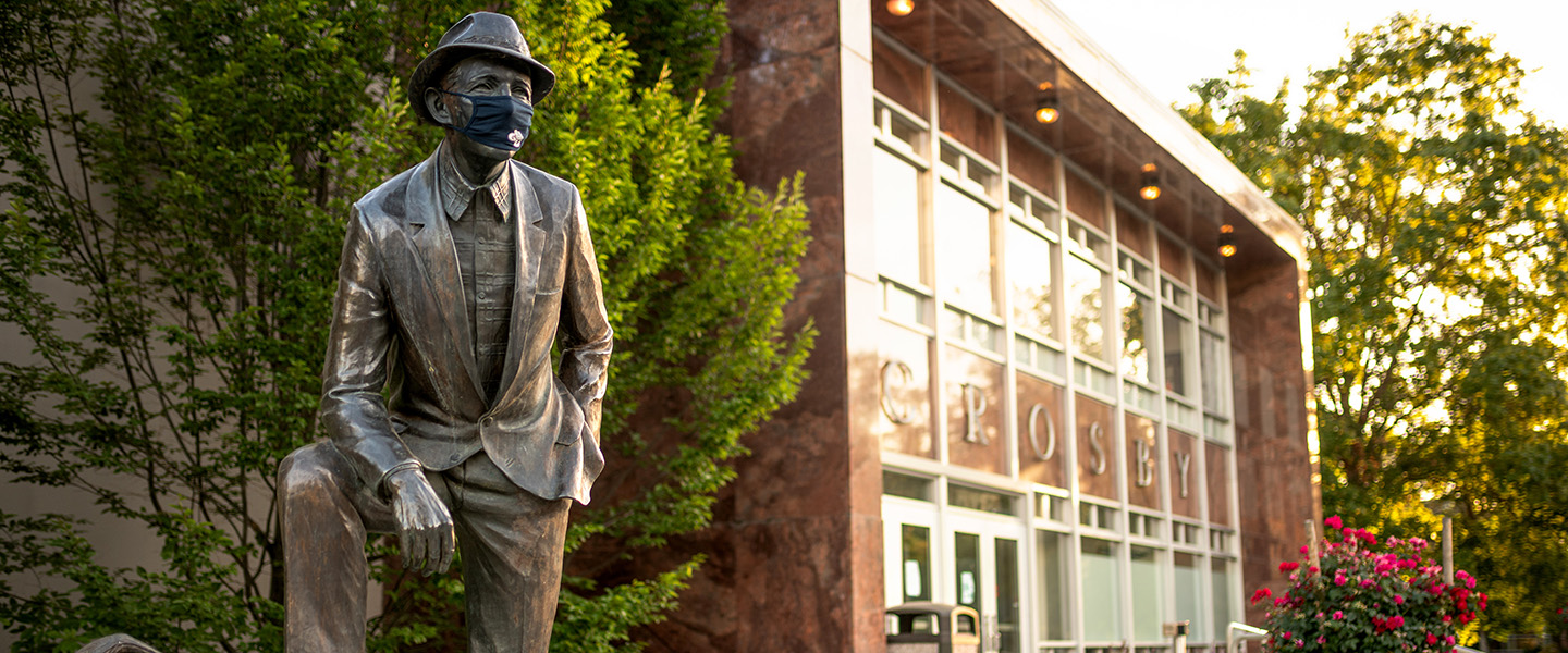 Bing with mask on campus.