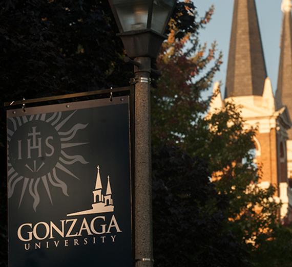 The morning sun shines on a Gonzaga sign.