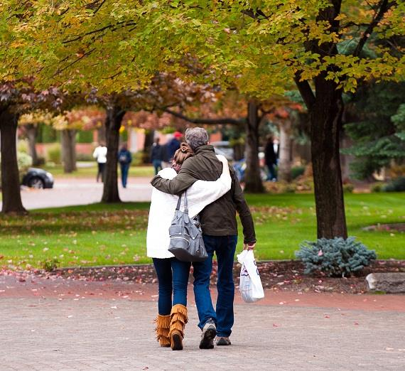 Walking and hugging during Fall Family Weekend.