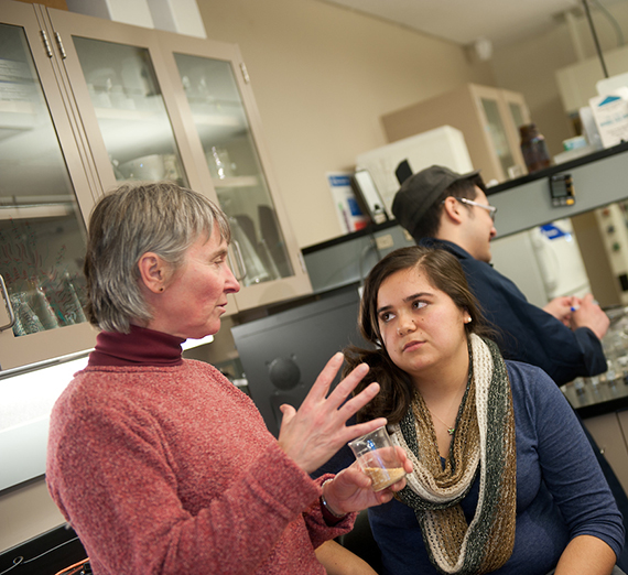 A professor explains a topic to a Gonzaga student.