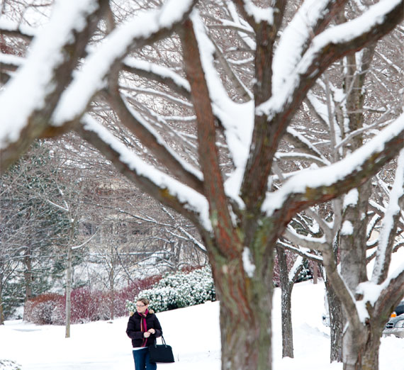 student walking on campus in the snow