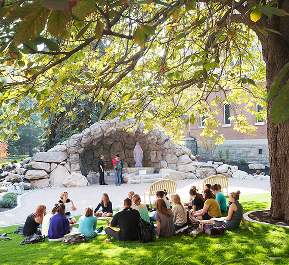 Class is held on the grass in front of the Grotto