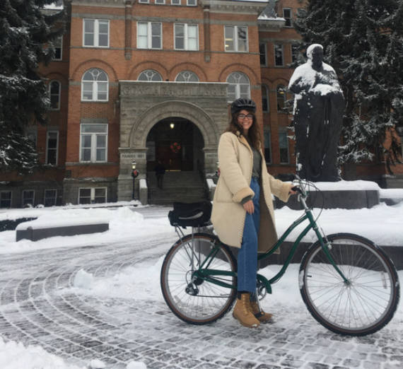 girl on bike on gonzaga campus