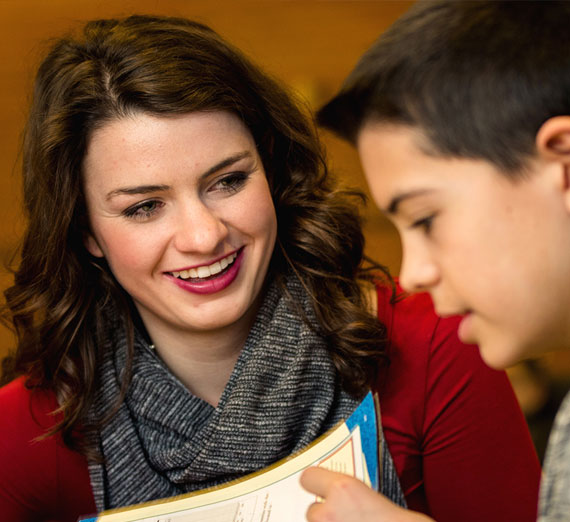 Gonzaga University student Madison Rose mentoring a middle school student