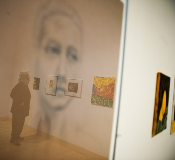 A person viewing the Senior Thesis Exhibit