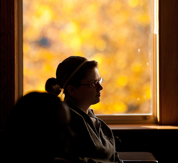 A student listens to a lecture from Psychology Professor Monica Bartlett.