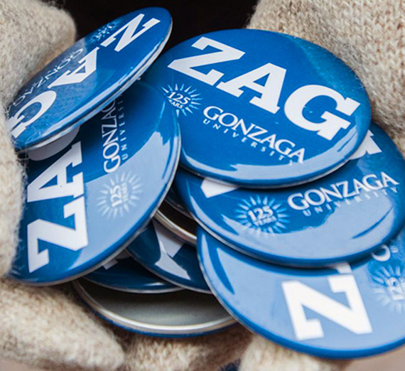 Person holding Zag buttons