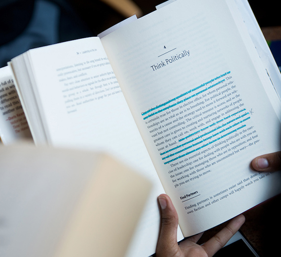 "Image of an open book with a chapter title ""Think Politically"""