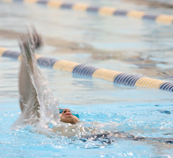 A swimmer competing in the pool