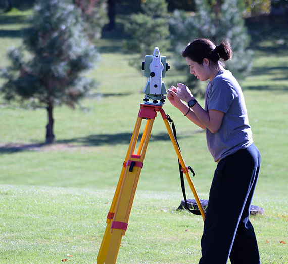 Student surveying campus
