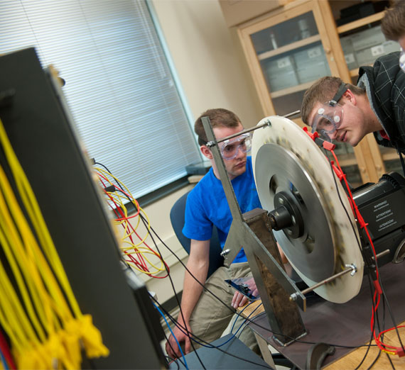 Electrical engineering students working together in a lab