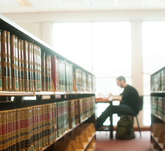 student studying in law library