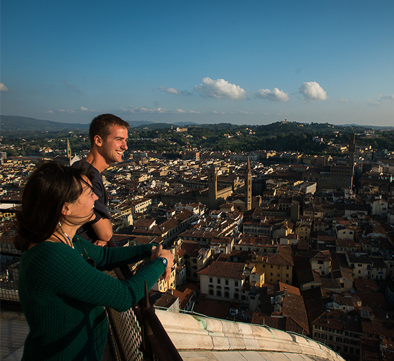 A couple overlooking a city in Italy