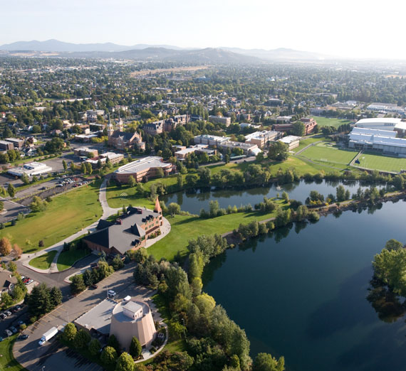drone view of spokane river and campus